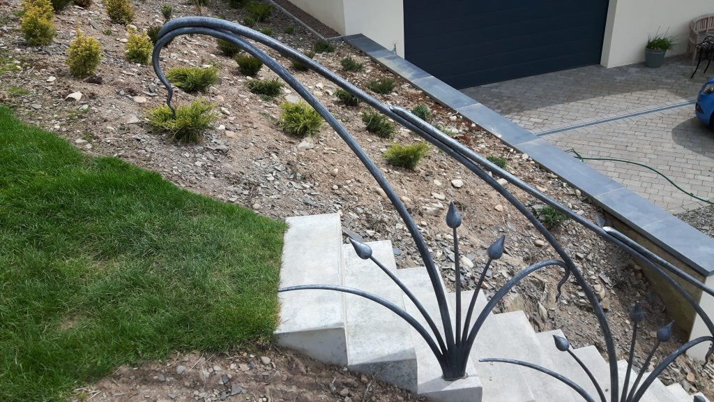 Stylised plant form handrail top detail