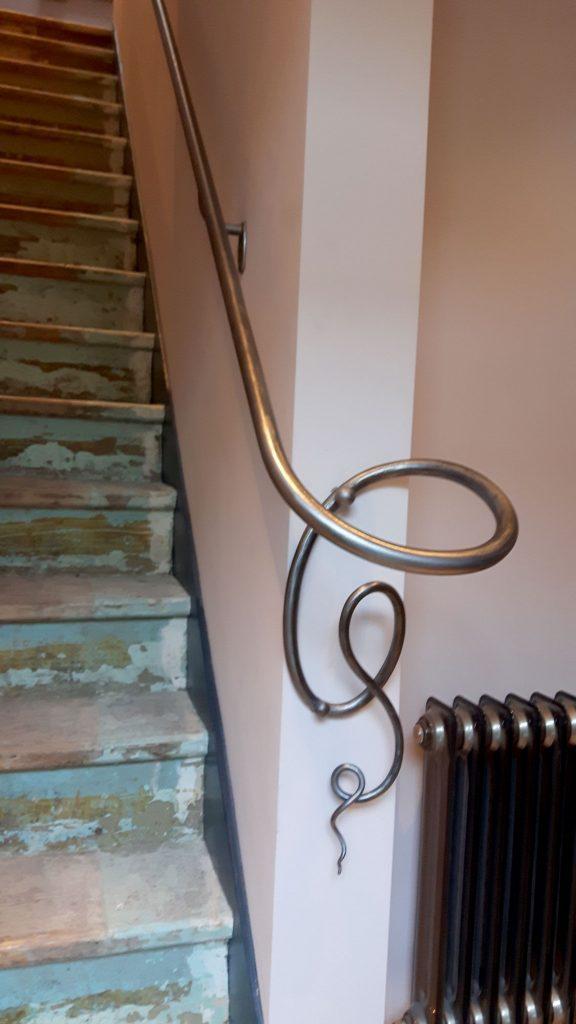 Blowing ribbon handrail bottom detail